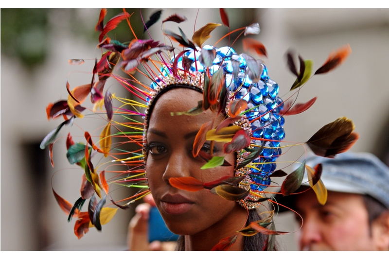 I don't care how many flightless papua new guinean birds gave their butt feathers to make this, it's awesome. The rhinestone-studded showercap I can do without.