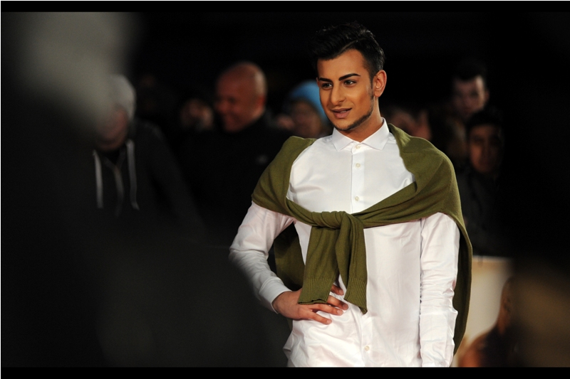 """""""Oh, this old thing? I threw it on without even looking. I mugged some old lady for the jumper, though, just so I could look extra cool by having it around my shoulders. I regret nothing""""  (later identified by wireimage.com as Junaid Ahmed)"""