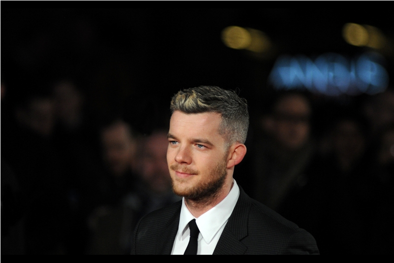 Much as I like this shot of Russell Tovey (and I do) the easily distracted part of me notes that the configuration of two yellow lights and blue squiggle in the background behind him makes it look like there's an animated light-monster with two eyes and a row of spiky teeth.