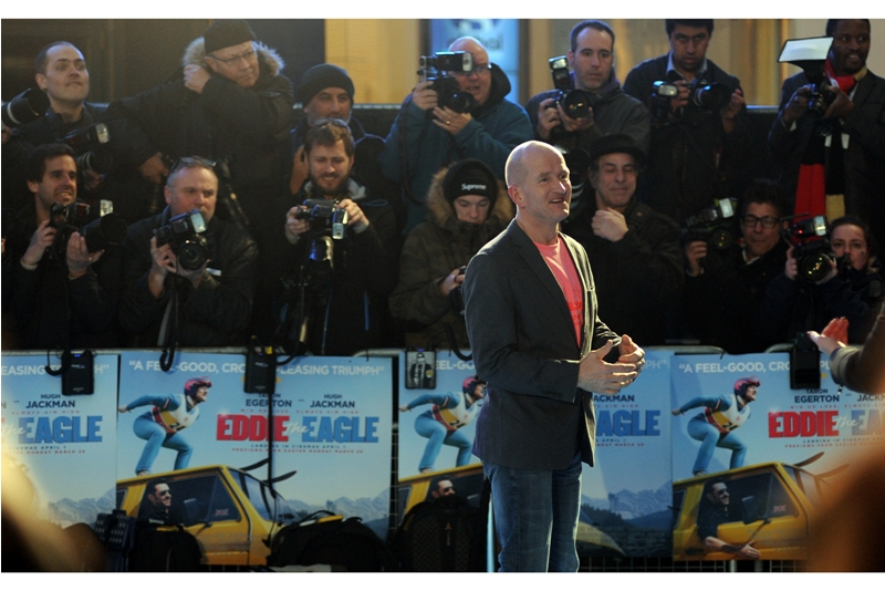 """The Man Himself, Eddie """"The Eagle"""" Edwards arrives, to both the sounds of cheers and anguish of  """"Wait... if that's Gary Barlow then what happened to his lustrous hair??"""""""