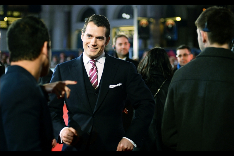 Henry Cavill looks pretty much like I'd imagine how somebody who just kissed Gal Gadot would look.