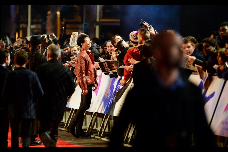 I believe this is Ezra Miller, who will play The Flash in upcoming films, assuming this Warners/DC Universe takes off. Which, to be fair, is going to happen no matter how bad these movies are because quality bears no strong correlation to box office in this world.