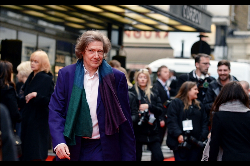 """""""That's not a scarf, baby... it's a new kind of tie I just invented. Right now.""""  If I had to guess, I'd guess this is Guy Hibbert, the writer of the screenplay. That's because generally only writers and director Terry Gilliam wear scarf/capes to premieres."""