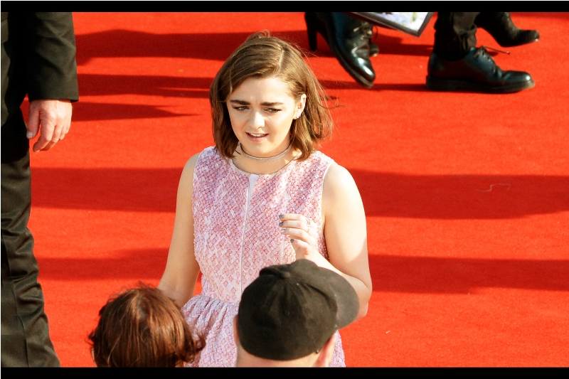 Thank the many-coloured god, I recognise who this is : Maisie Williams is Arya Stark on Game of Thrones.