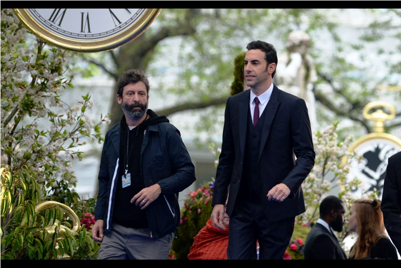 "Sacha Baron Cohen plays the character (and/or notion and/or fourth-dimensional metaphysical representation) of ""Time"" in this movie. I guess that means Disney has trademarked that too, now."