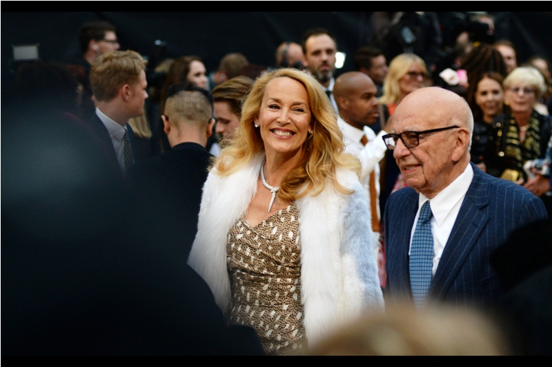 It's former Rolling Stone wife and Joker's sqeeze Jerry Hall, and her husband ... ummm....
