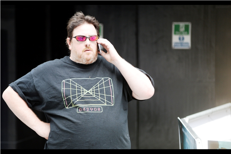 """""""Can't talk, Mom. There's a lamppost over there that needs me to lean seductively against it"""".  I do like the t-shirt, though."""