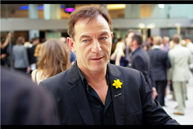 Jason Isaacs played the villainous Lucius Malfoy in the Harry Potter movies (the last four of whch were directed by David Yates, who directed his film). The daffodil he's wearing might have been a pretty evil one in some movie. I don't know.