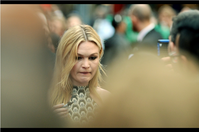 The tribulations of getting a good photo of Julia Stiles continue, as I take to having to shoot between bald heads for this photo (or maybe it's one very deformed head... I was too busy being frustrated to notice the details)