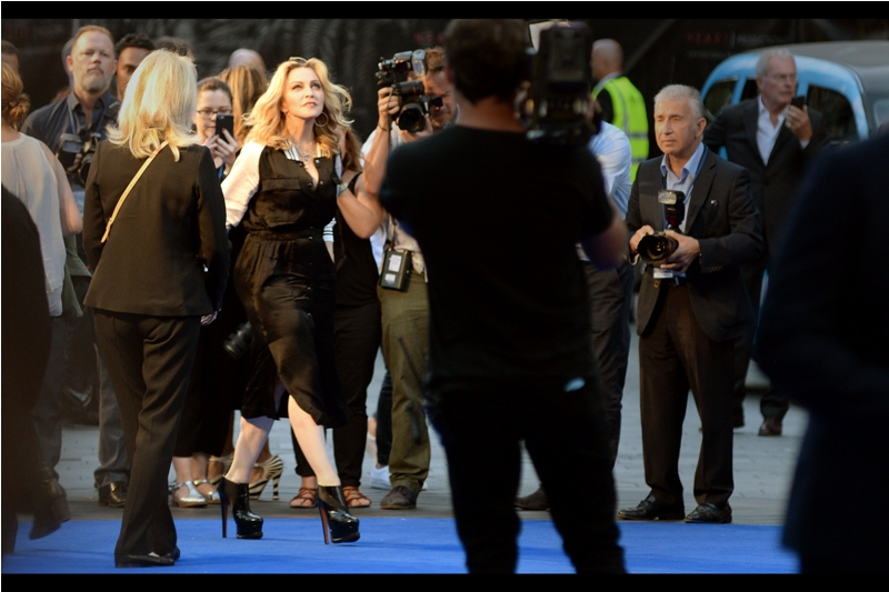 "Random attendee : Madonna! (I last photographed her at  the premiere of the movie ""W.E.""  which she directed back in 2012). The tourists to my right were totally flummoxed at the attendees this premiere was generating. I'm just stoked the Nikon's autofocus is pretty sweet at this distance.."