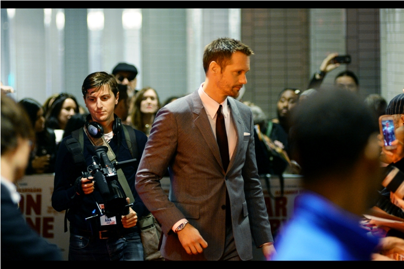 "Anyway, our first arrival from the movie is Alexander Skarsgård, looking dapper in a suit most of the ladies in the crowd would be happy for him to remove, if for no other reason so they can see if he's the same Alexander Skarsgård who was in the movie  ""Legend of Tarzan"" (he was)"