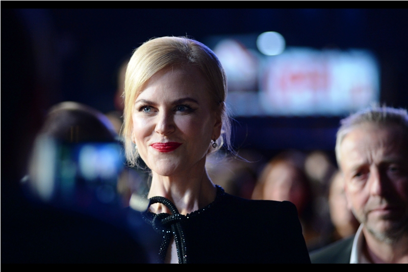 """Nicole Kidman, with an expression that says  """"Bring The Thing You Want Autographed Today Because Today I Would Have Signed It"""".  The dude on the right has an expression that more or less mirrors mine right now."""