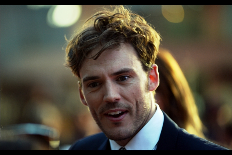 "Sam Claflin is best known for his presence in the  second ,  third  and  fourth  Hunger Games series of movies. Plus I photographed him a few weeks ago (or ""May, 2016"") at  the premiere of ""Me Before You"""