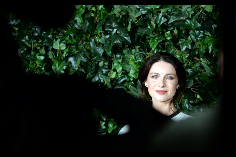 I don't know who she is. Also, I don't know what the species of plant behind her is, and I don't even know how many paparazzi elbows I'm shooting through in this photo...  (Edited to add : Irish actress Caitriona Balfe)