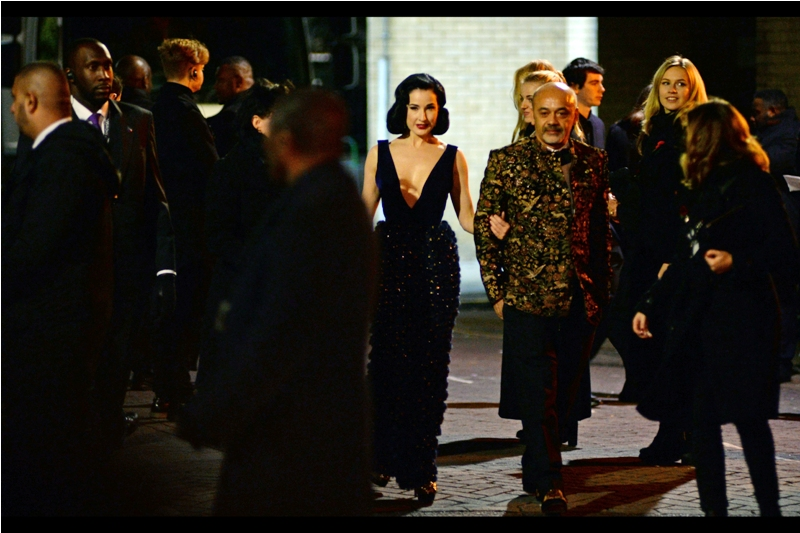 Typically, when a magic amulet is broken up and its pieces buried in different parts of the globe to nullify its powers, it's too dangerous to let them be in the same place. I can't help but feel that (1) Dita von Teese's dress, (2) That guy's shirt, and (3) John Malkovich's trousers are three of the four parts of an amulet that shouldn't be allowed to be this close.