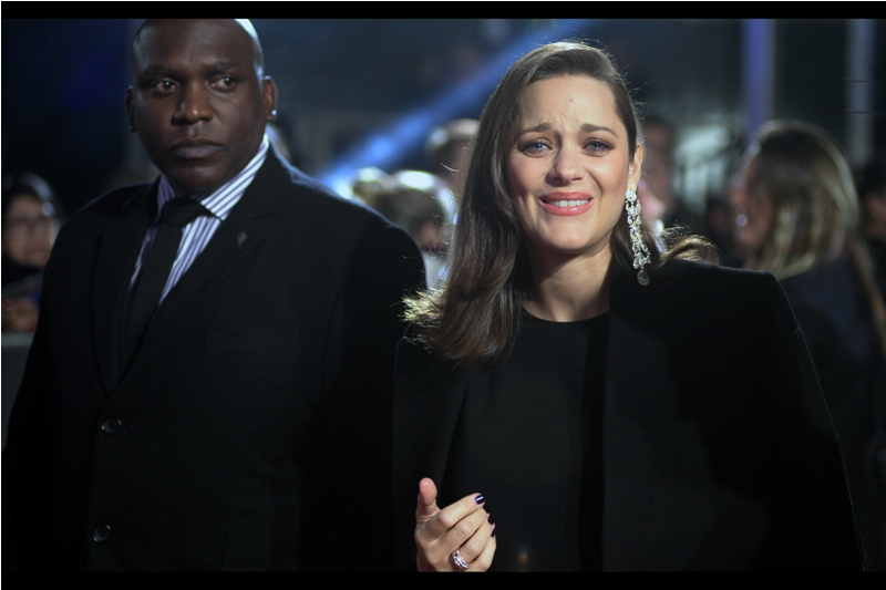 All things being equal, I'd prefer to photograph Marion Cotillard briefly smiling than having her earnestly apologise for not smiling.