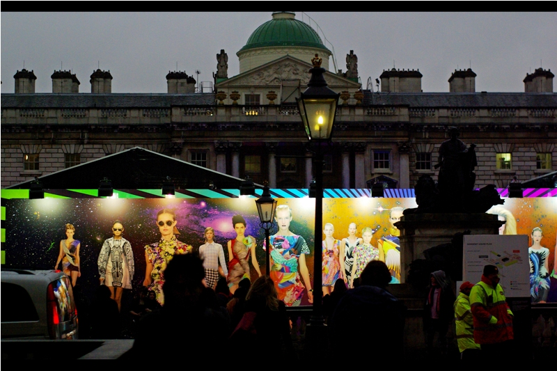 """From within the bowels of London Fashion Week HQ :  """"We spent thousands on that mural and they're parking vans and putting neon-jacketed security people in front of it??"""""""