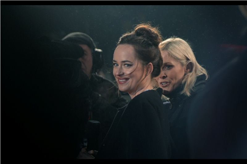 Despite the best efforts of the people around me to all simultaneously jump up and hold up their mobile phones at once, I manage to take a proper photo of Dakota Johnson. I last (sort of) managed that feat at last year's  premiere for 'How To Be Single'