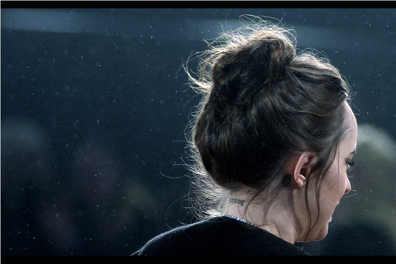 "Although they could as easily be hieroglyphs, cyrillic or a radical new numbering system being devised by Security for upcoming premieres, it seems that the tattoo on the back of Dakota Johnson's neck reads ""bmor"". Not sure that's helpful, but you're welcome."