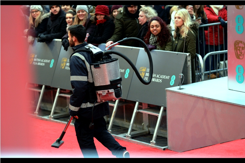 """Somebody spotted a cockroach on the third floor, and I don't mind telling you : it looked fabulous"".  Those might not be actual Swarovski crystals embedded onto that vacuum cleaner, but even the fact that they sprung for fake ones speaks volumes for the classiness of the Baftas."