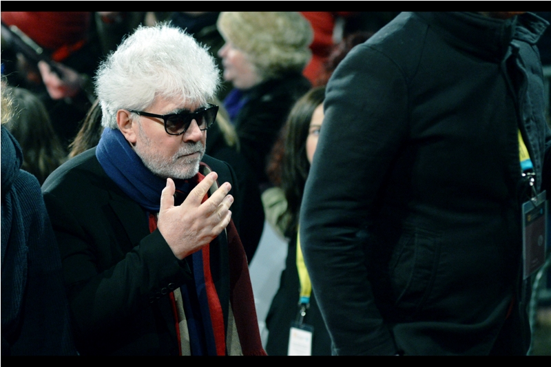 Director Pedro Almodovar, hoping like hell that Director Terry Gilliam, whose oustanding choice of scarves and/or dishtowel capes are a feature of many a premiere or event, doesn't show up with something even more enticing.