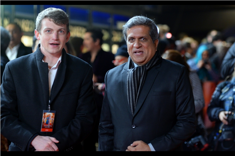 """""""We gotta keep up this mirroring thing we've got going. It's crazy-effective""""  - the man on the right is Darshan Jariwala, while the man on the left presumably works locally and is not a twin/double."""