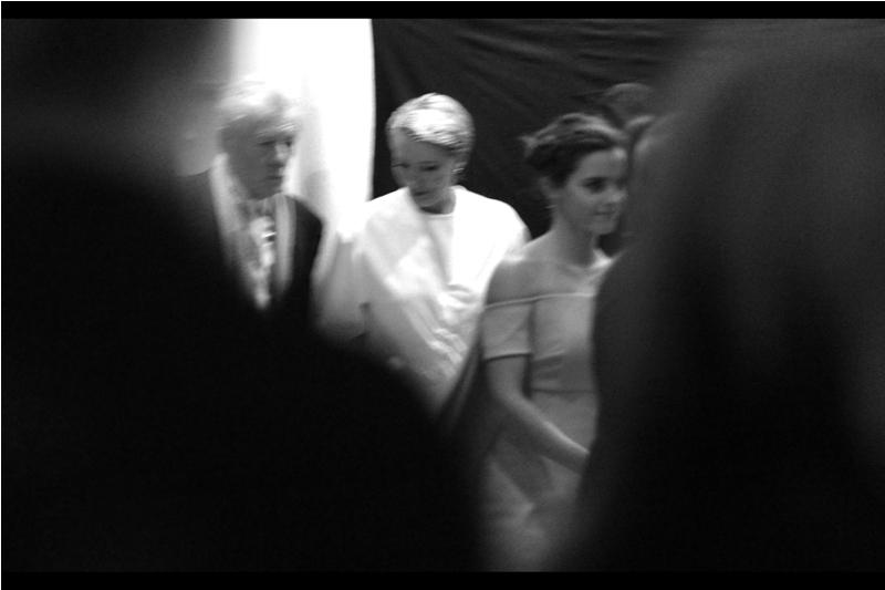 Emma Watson has appeared, and it seems that the screams from the crowd outside (the vast VAST majority of whom can not even see her) alone are enough to create a concussion wave I'm having difficulting holding my camera steady through.