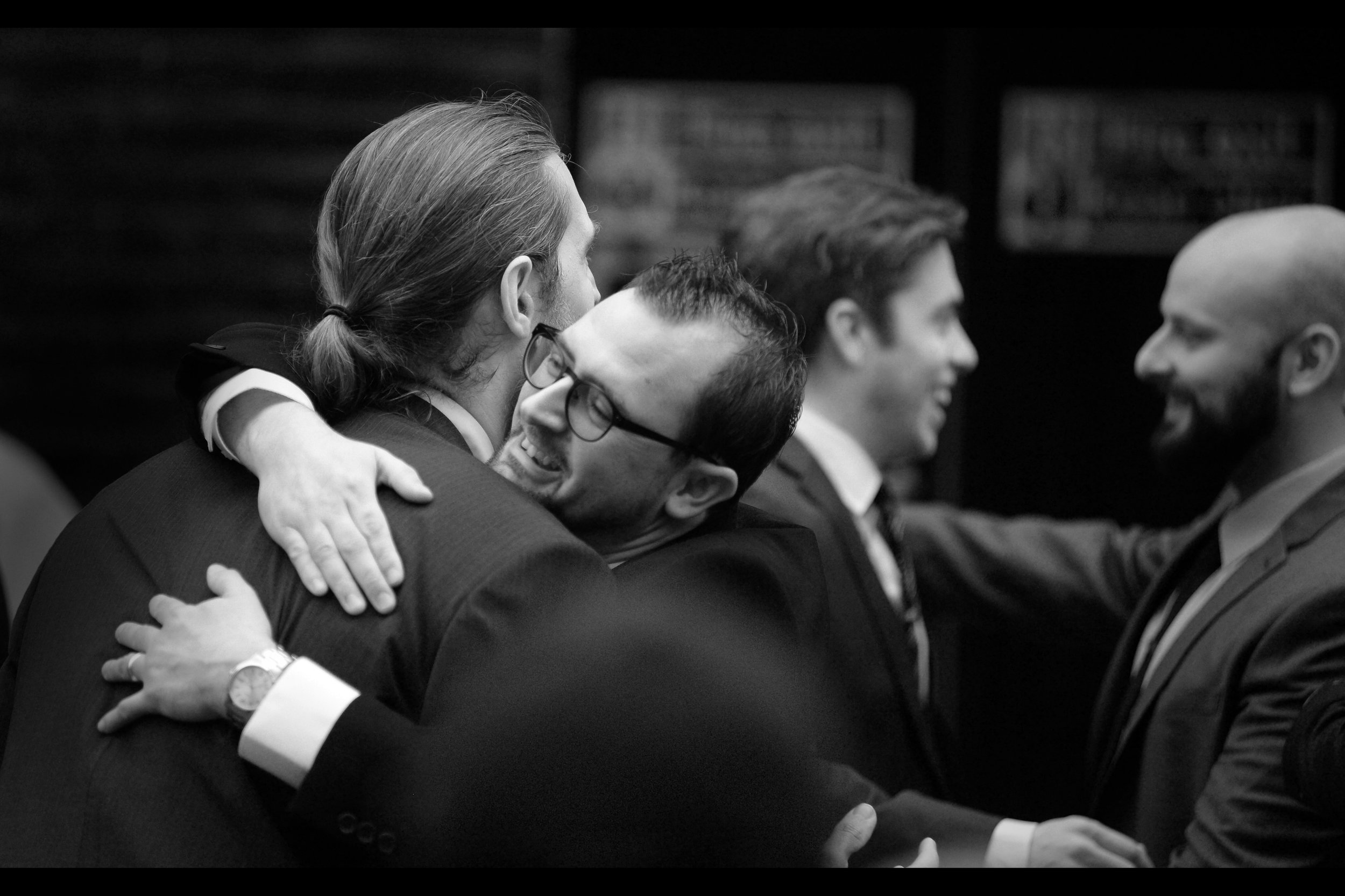 People hugging people usually means they're in the movie. Or perhaps just naturally affectionate in public places.  (edited to add : he's the director, Gene Fallaize)