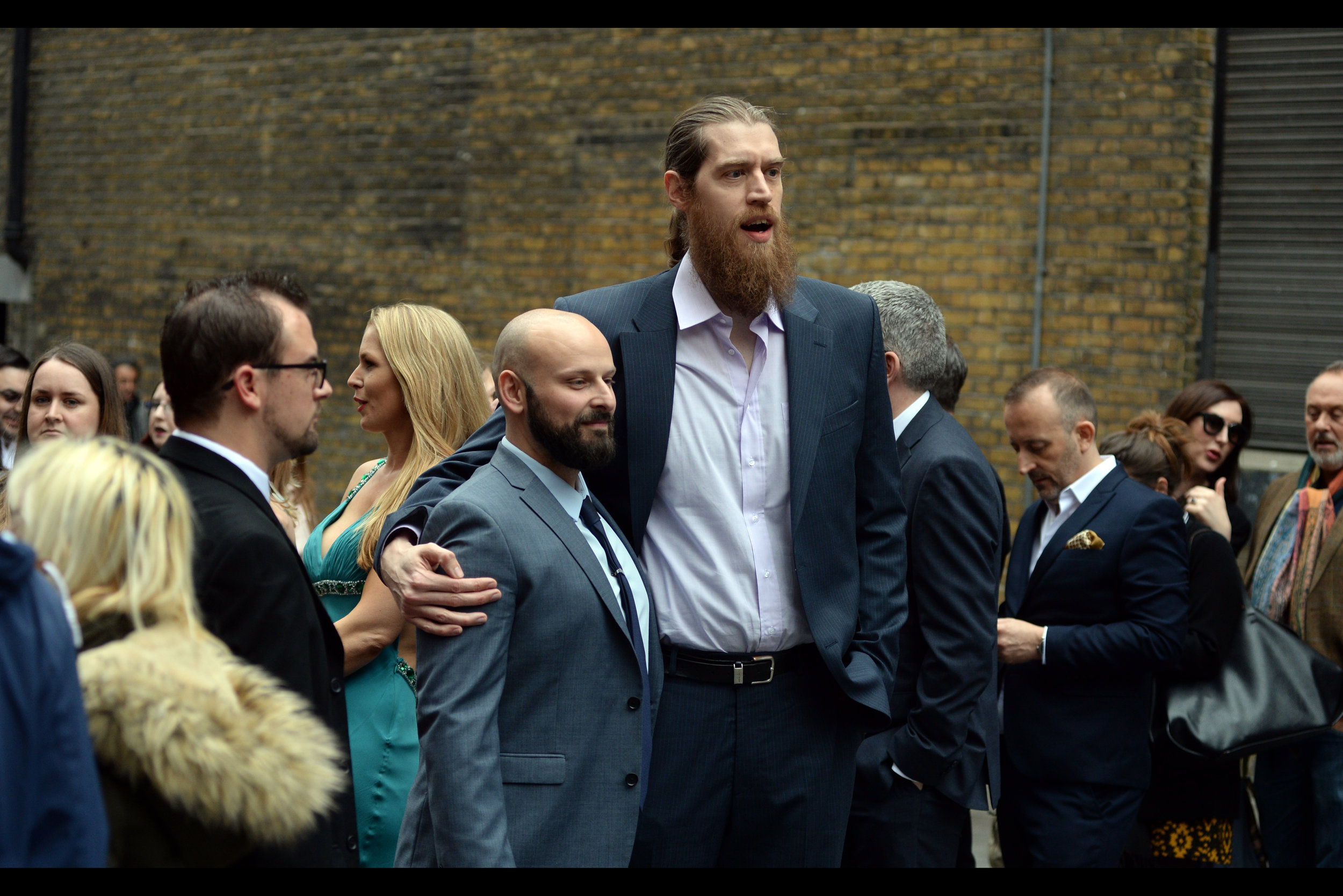 """""""This man... is shorter than me. That's all I've got for now"""" -  I think the shorter guy might be Tony Cook, who is in this film and was also in 'Eastern Promises' and 'Shaun of the Dead'"""