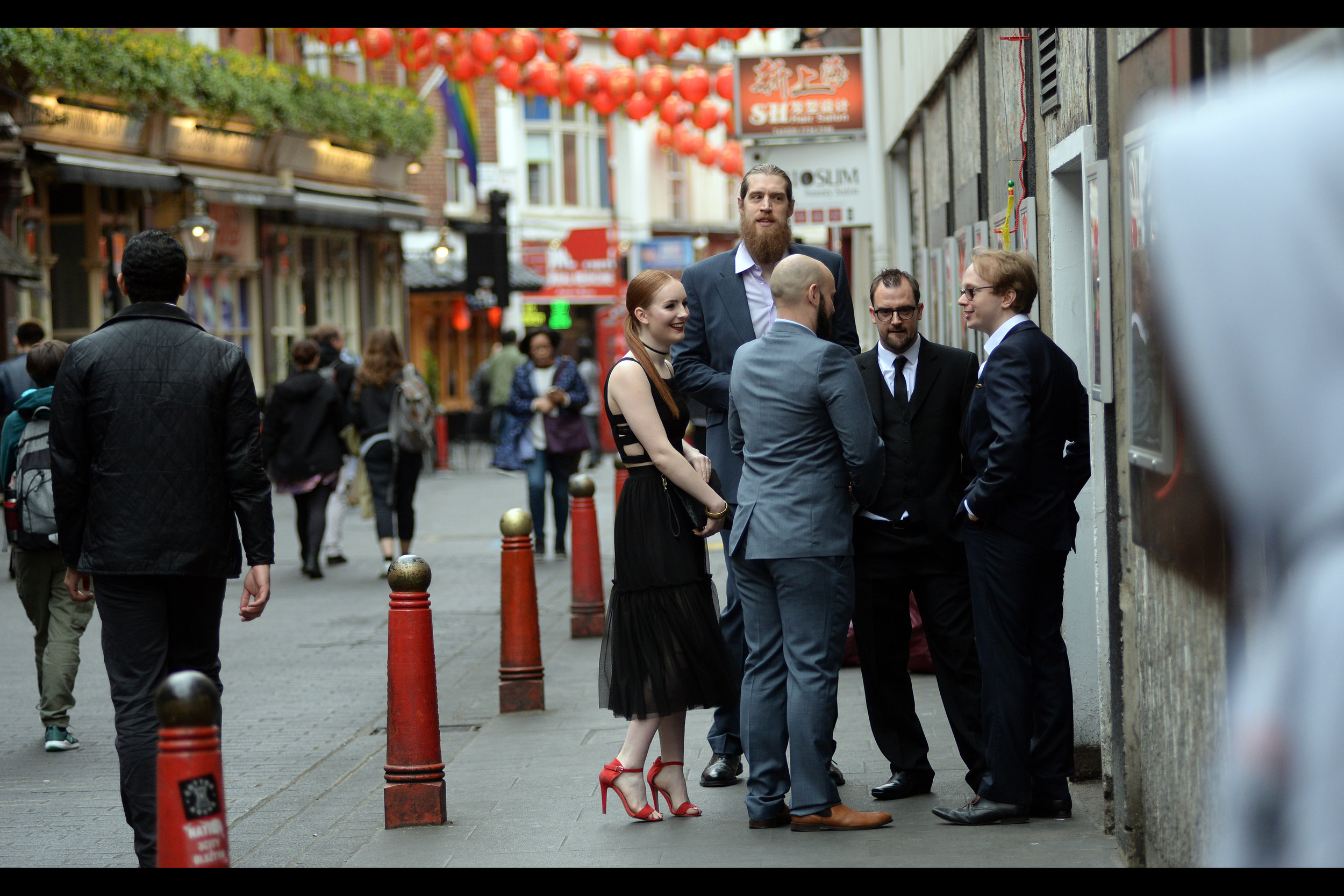 Meanwhile at the side/rear entrance, some of the cast and crew seem to have assembled. The man on the far right is Ben Mansbridge, I believe (uncredited as 'Constable No.3' in 2012's 'Les Miserables') while the man facing the camera second from the right is director Gene Fallaize.