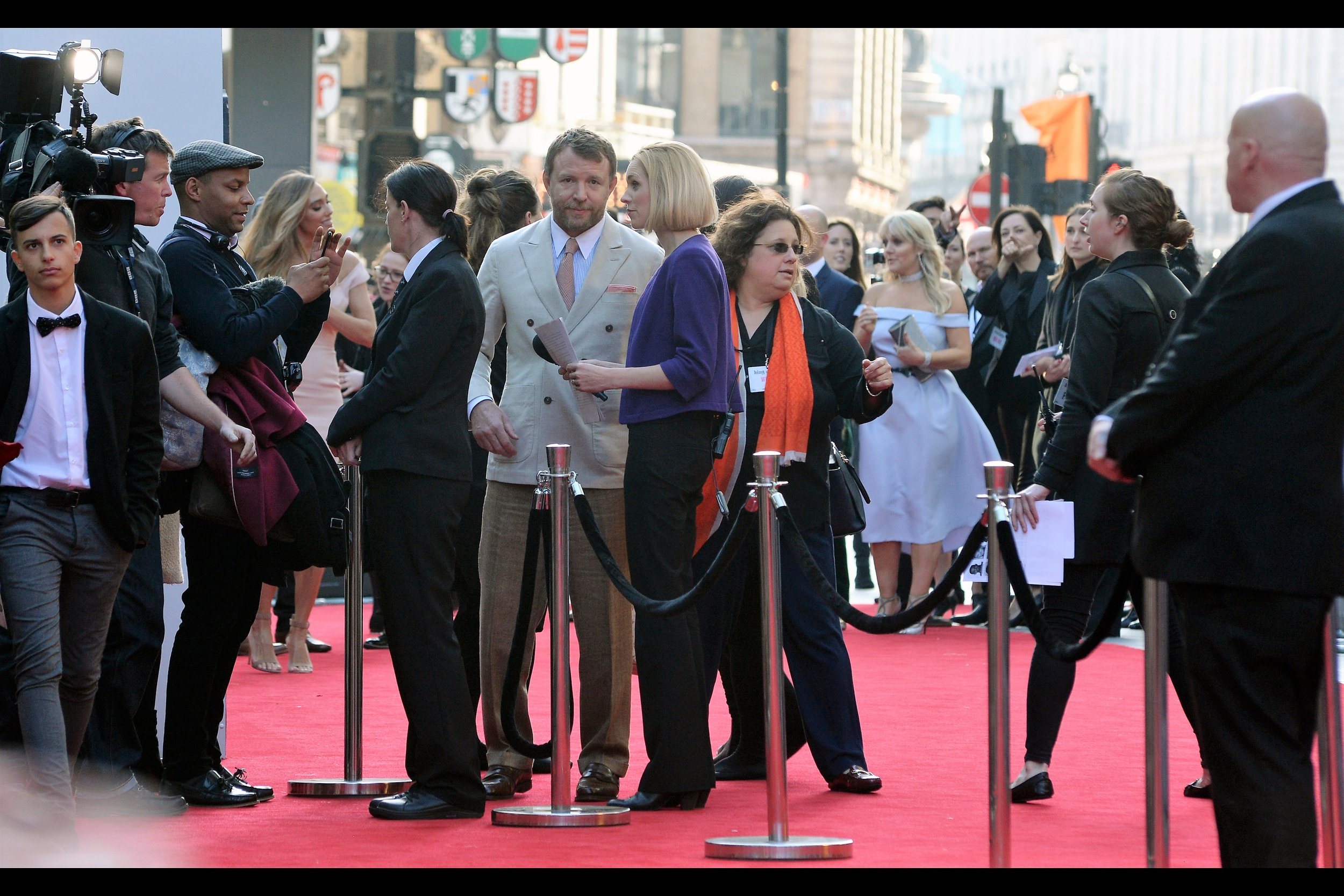 "Director Guy Ritchie's Jacket/Trouser colour combination is quite Pete Weller-ian in its similarity to Monday's   ""Jawbone"" Premiere  . I've previously photographed Ritchie at the premieres of   'RockNRolla'  ,   'Sherlock Holmes (2009)'   and - strangely- the documentary   'African Cats'"