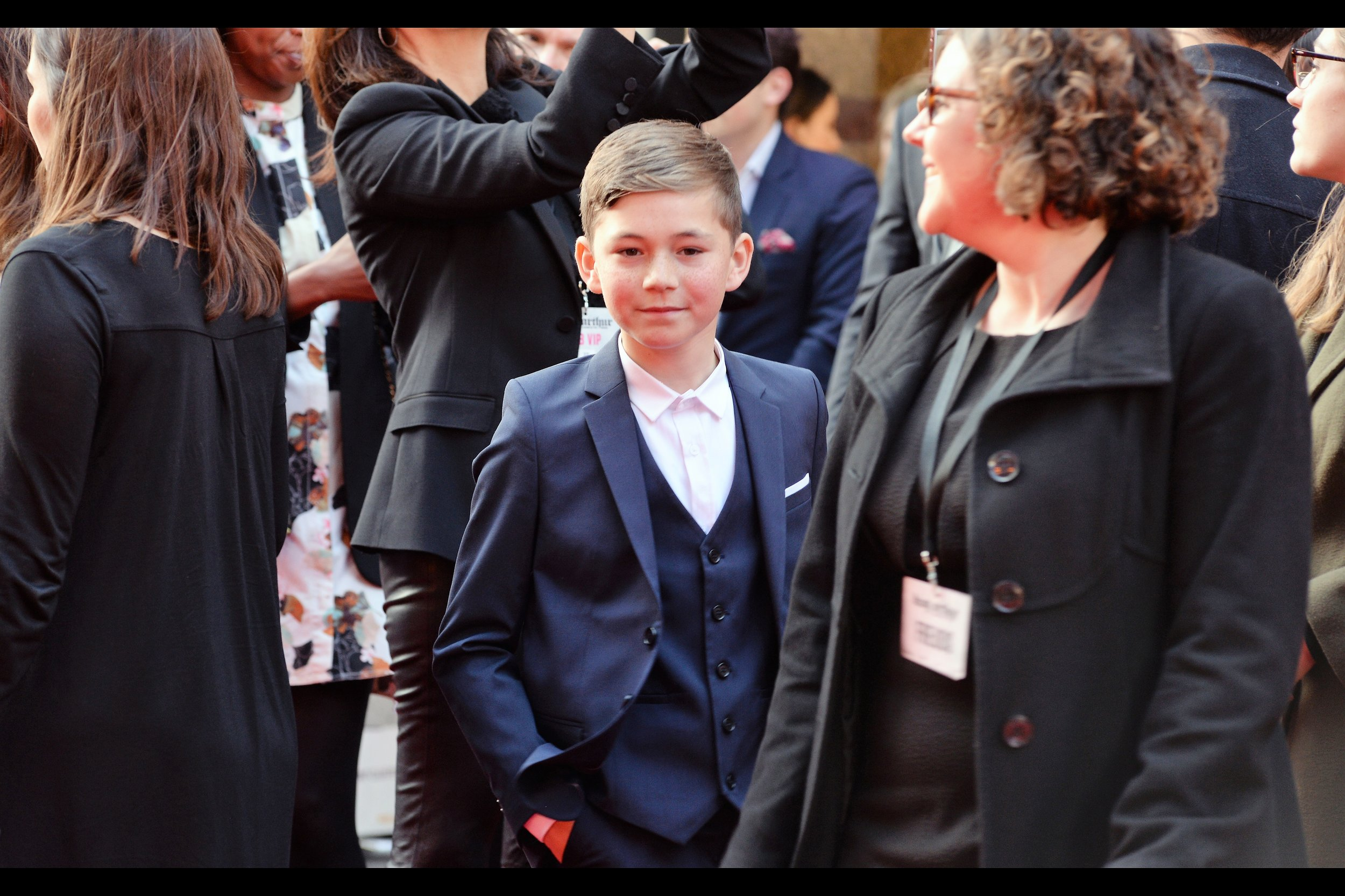 I think this is Hugh Robb, who plays the role of Arthur (age 11) in the film, which also has actors playing him at ages 2, 6, 19, and 'age of Charlie Hunnam'.   Edited to add : Correction : he's Bleu Landau, who is from Eastenders, and who is also in this film - with thanks to Jason Archer!