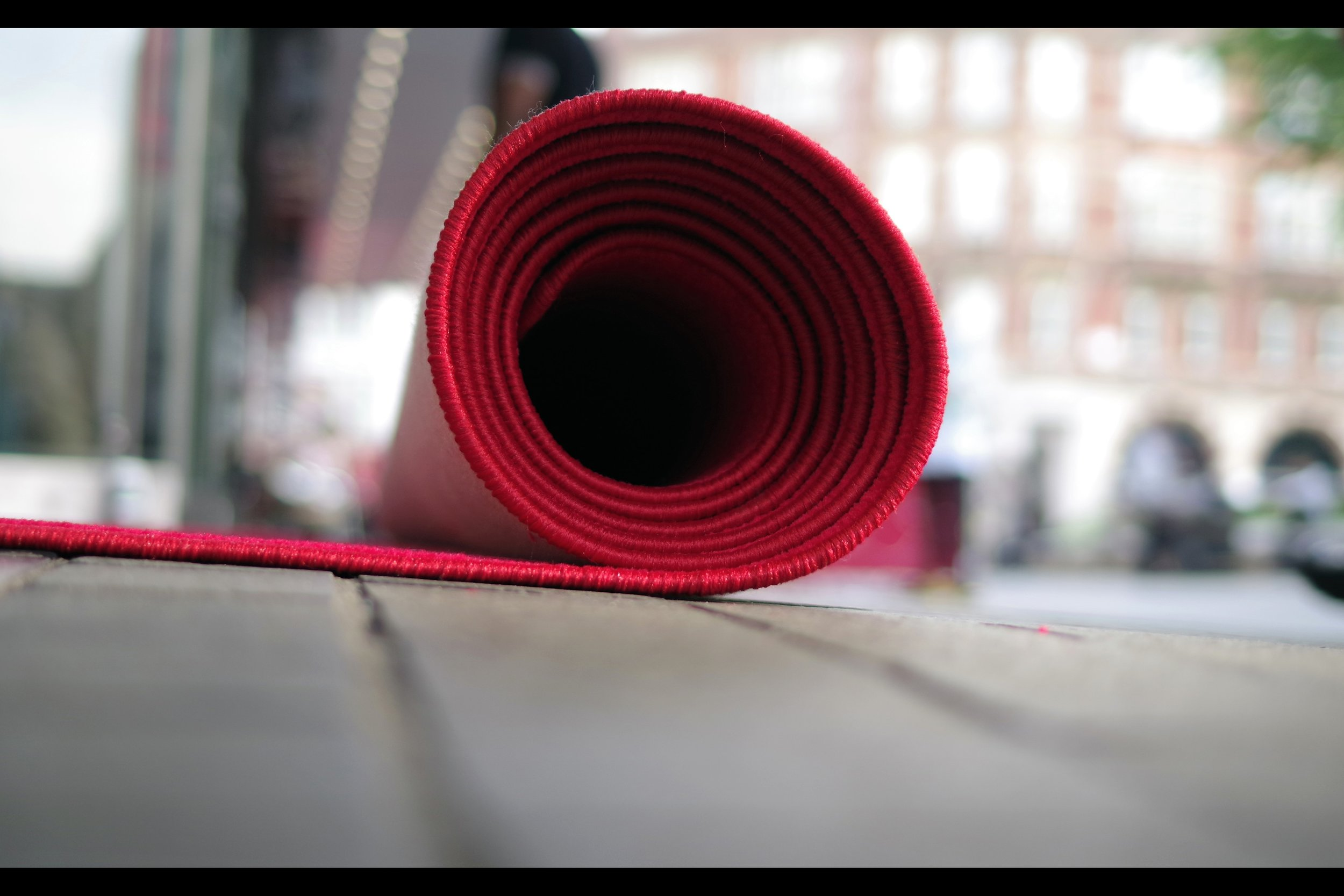Rolled up red carpet. (Not to scale).