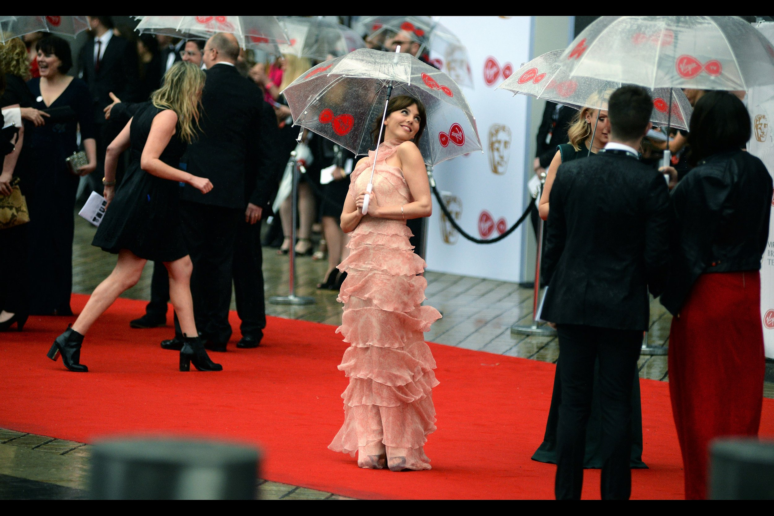 The imdb swears that Ophelia Lovibond played the role of The Collector's assistant in Guardians of the Galaxy (?), but I'm still to busy puzzling over whether the dress she's wearing is structurally possible in this rain. Or whether it needs it to survive.