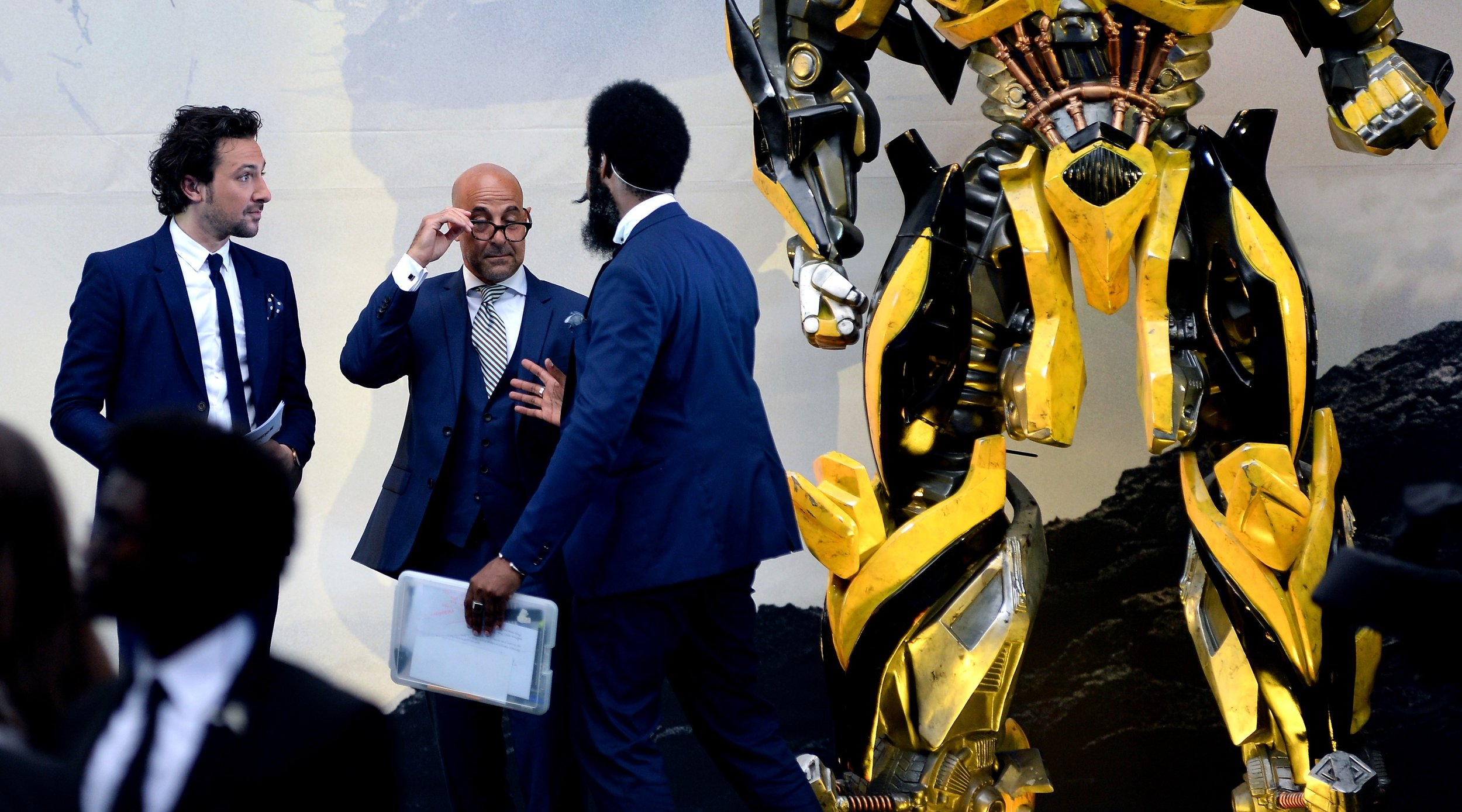 """""""Yes, Mr Tucci, we can confirm you're standing at the same level as Bumblebee's crotch as per your instructions"""""""