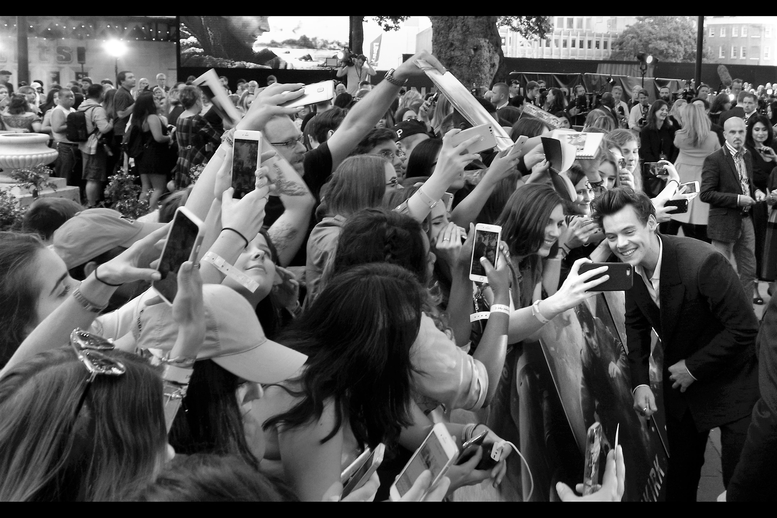 Fortunately the likelihood of rioting that would still probably be going on right now if he didn't, Harry Styles did indeed sign and pose for selfies for what seemed like the majority of the assembled crowd.