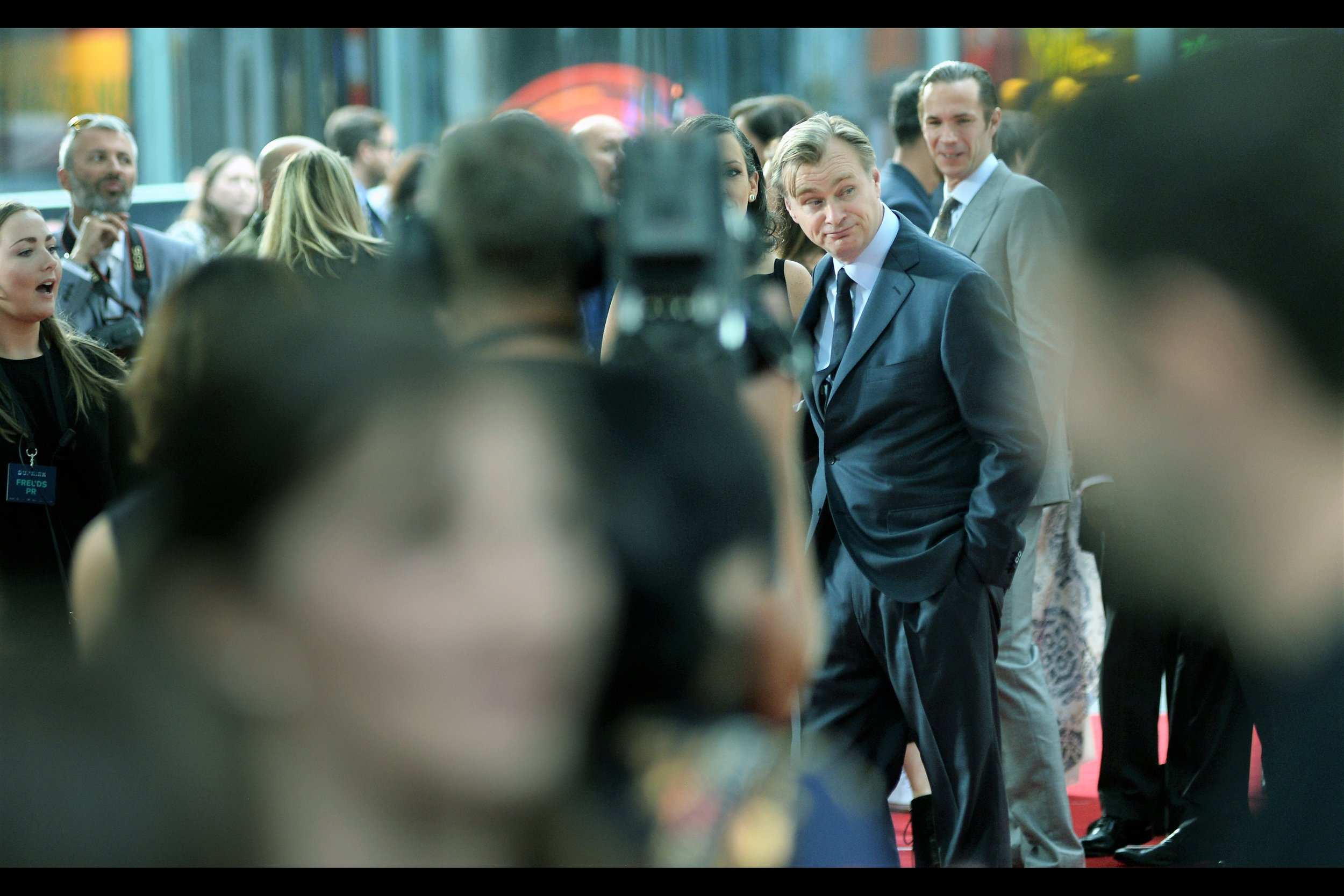 It's Christopher Nolan! I missed photographing him entirely at the premiere of   The Dark Knight ,  I was outside the premiere centre at the premiere of   The Dark Knight Rises  , I missed out on getting his autograph by about 1.5 people at the premiere of   Interstellar  , and in about 10minutes he's going to  almost  look at my Moleskine and decide....  nah... next time maybe.