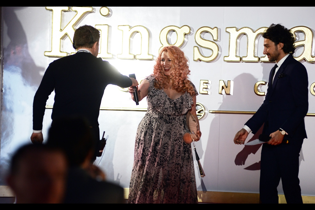 """""""This is not meant to be symbolic: sometimes a microphone is just something you speak into""""  Meanwhile, on stage : screenwriter Jane Goldman."""
