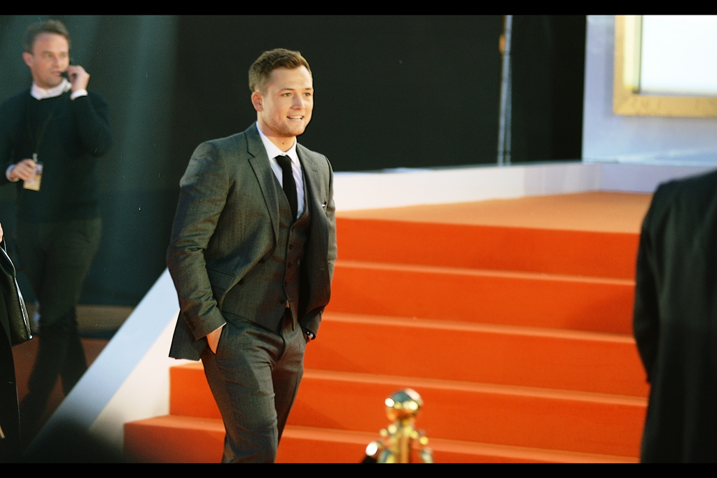 Taron Egerton *finally* passes by the main stage, but decides against being interviewed on it.