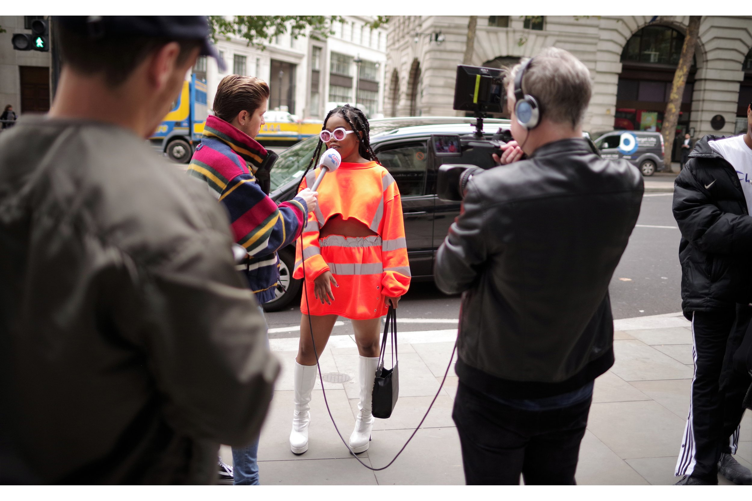 """""""We're calling it """"Health and Safety Chic"""". We're pretty sure it'll catch on. The boots are fabulous, after all"""""""