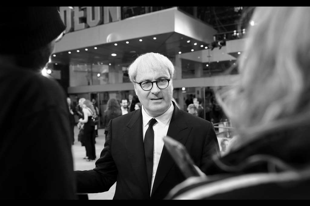 """""""What are you doing here? All the best photos to be taken at this premiere require you to specifically NOT be inside the premiere"""" . Well.... yeah. Director Simon Curtis is probably best known for directing 'Woman in Gold' in 2015, and   'My Week With Marilyn' in 2011."""