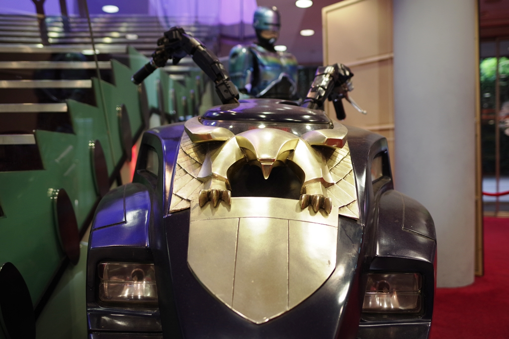 Mix'n'Match Franchises : Robocop II suit behind Judge Dredd's bike - both franchises have since had attempts at reboots - Robocop's was a neutered failure, Dredd's was good but arguably not successful enough.   (Whining bid for the Bracelet of Anubis: £5,500)
