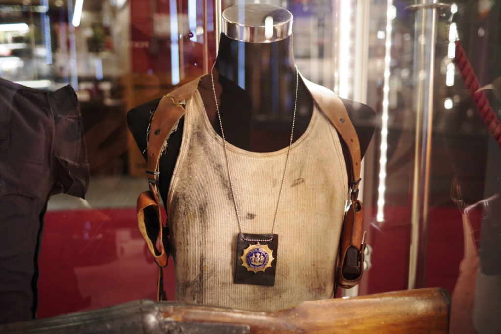 John McClane's gear from Die Hard : With A Vengenace (oil and grease lovingly applied, I'm sure)   (Winning bid for the bullet-riddled 'metallic' 'shirt': £3,000... which surprises me a bit)