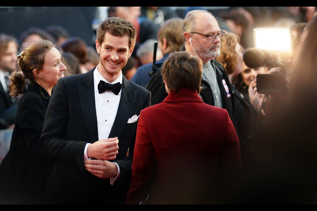 """Are you answering my question, or are you eyeing the cute girl with a crush on a protesting bongo player?""  My spot in the long main pen has no direct view to the drop-off or paparazzi cordon, so I didn't actually get a chance to photograph the stars until they got quite close. In this particular case, lead actor Andrew Garfield."