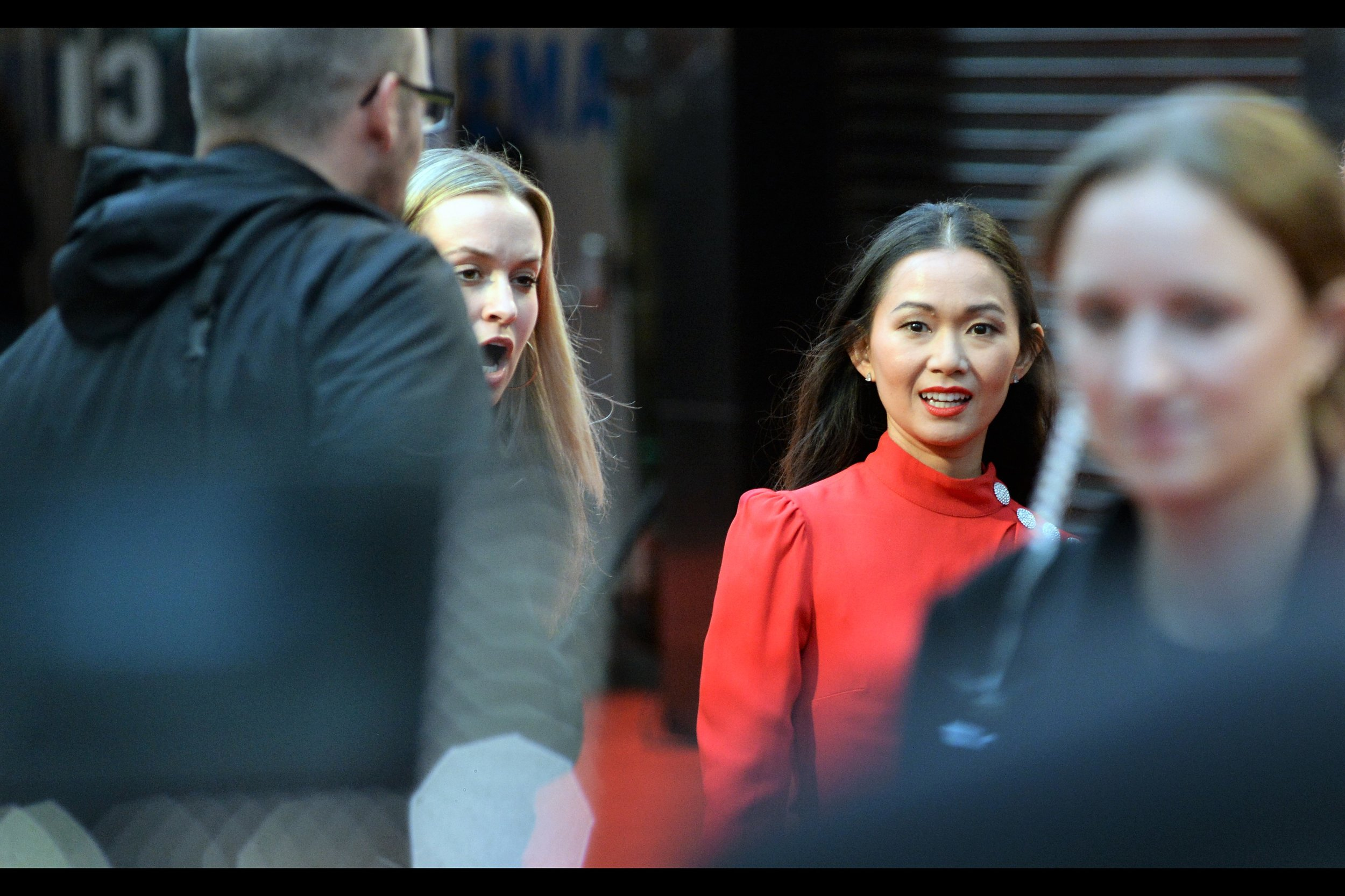 This is Hong Chau. I can not see her P.A., but I'm relieved it's not the giant balding security guard who hovered over her when she got out of the car.