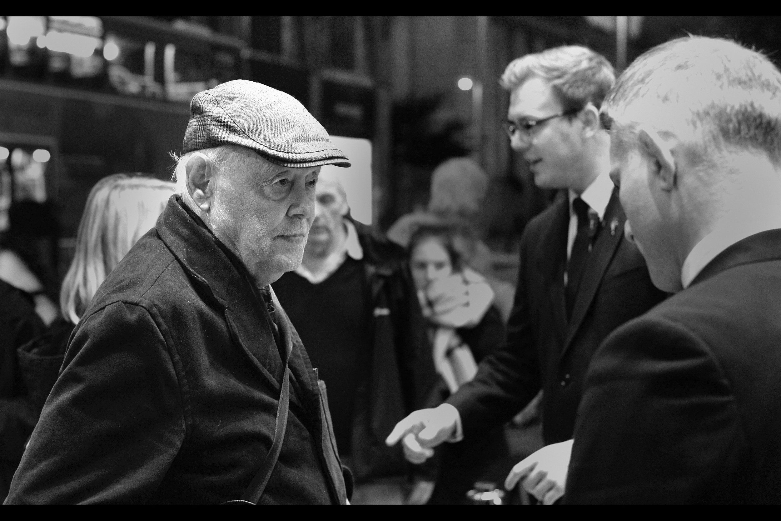 "Remarkable catch by a wizard in our pen : this was later identified as Dudley Sutton, who I last photographed at the premiere of   ""Outside Bet""  , where I wrote a comment I'm going to reheat and place right here:  ""Ordinarily I'd merely comment on the hat and then move on. But my favourite sentence from his wikipedia entry is :  ""In August 2003, he performed the one-man 'Killing Kittens' show at Edinburgh's Underbelly"".  "" - well played, Me In 2012."