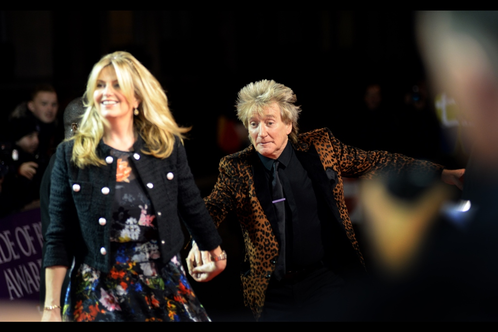 Photo would look slightly more convincing if rocker Rod Stewart's girlfriend / wife / lady friend / parent-guardian was similarly stumbling or running on the carpet.