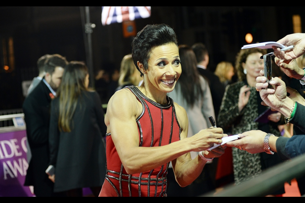 """Did I hear you want to challenge me to an arm wrestle?""  Dame Kelly Holmes is/was a dual Olympic gold medallist in running events."