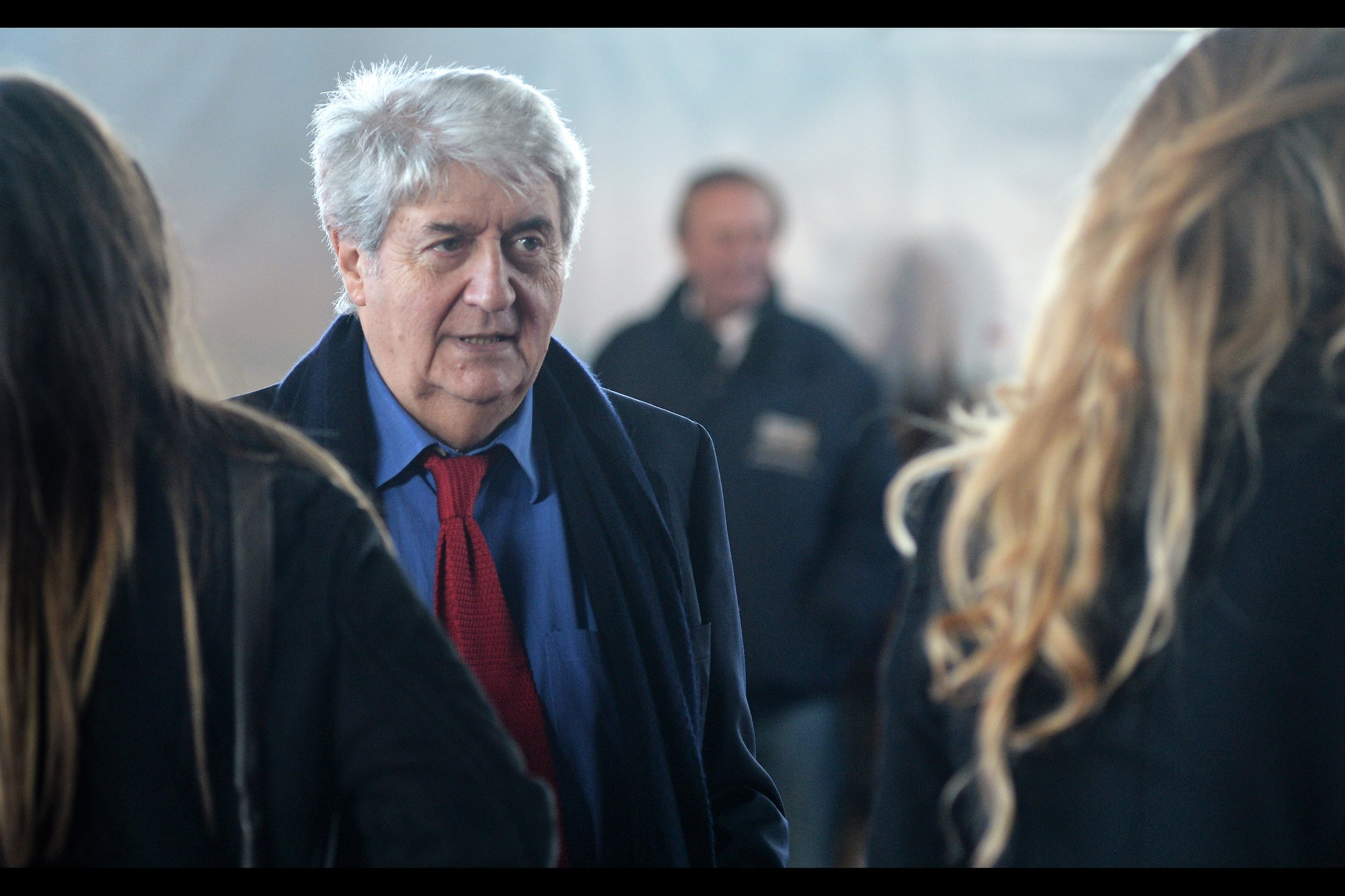 Tom Conti also played the role of 'Prisoner' in 'The Dark Knight Rises' - and... yeah, he does look familiar! (I think!) (he wasn't wearing a tie in the movie..)
