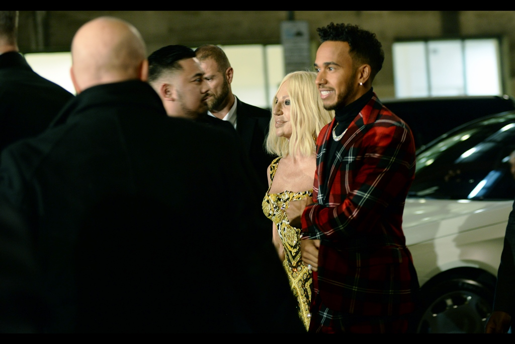 Lewis Hamilton and Donatella Versace are possibly the power couple you never knew you always wanted to see walking a red carpet together. I also think if she was wearing a dress with his pattern and he was wearing a jumpsuit made of her dress pattern, their combination would work almost as well.
